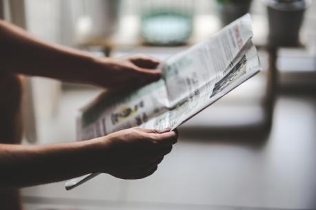 man-read-newspaper